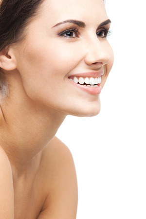 Close up portrait of beautiful young happy smiling woman photo