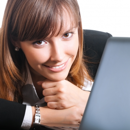 Happy smiling young businesswoman working with laptop, isolated over white background photo