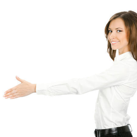 Portrait of young cheerful beautiful business woman giving hand for handshake, isolated on white background photo