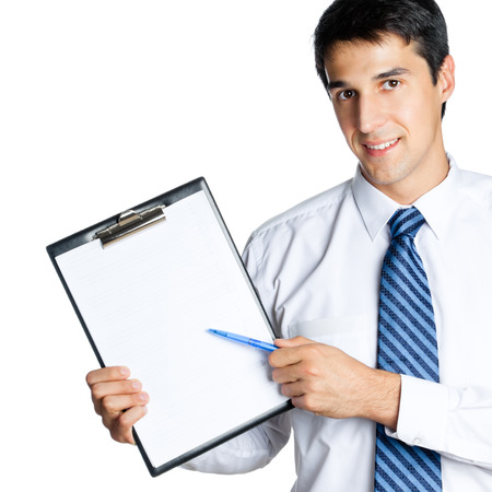 Businessman showing clipboard, isolated on white photo