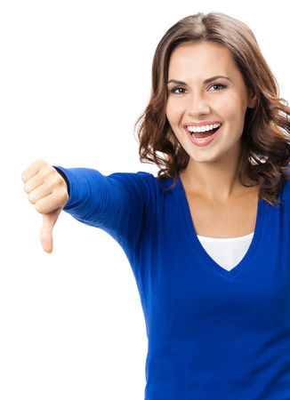 Happy smiling beautiful young woman showing thumbs down gesture, isolated over white background photo
