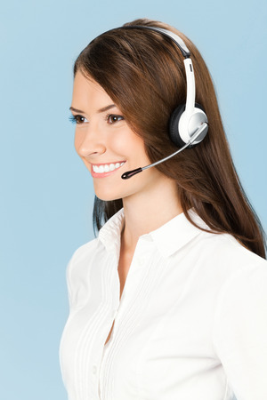 Portrait of happy smiling cheerful customer support phone operator in headset photo