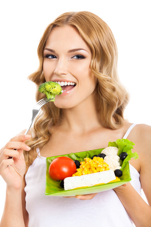 Portrait of happy smiling young beautiful woman with healthy vegetarian salad, isolated over white background photo