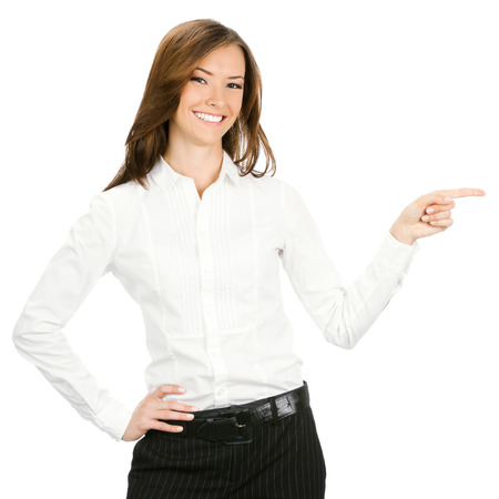 and the area: Happy smiling young beautiful business woman showing blank area for sign or copyspase, isolated over white background