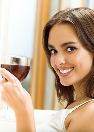 winetasting: Portrait of young happy smiling cheerful beautiful woman with glass of red wine