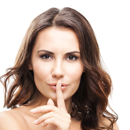 hearsay: Portrait of beautiful woman with finger on lips, isolated over white background