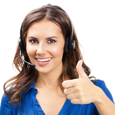 up service: Portrait of happy smiling cheerful young support phone operator in headset showing thumbs up gesture, isolated over white background Stock Photo