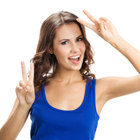 2 persons only: Happy smiling beautiful young woman showing two fingers or victory gesture, isolated over white background