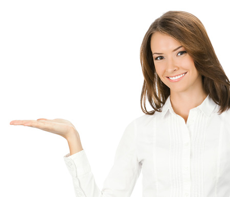 Portrait of young happy smiling businesswoman showing something or holding with copyspace, isolated over white background Stock Photo