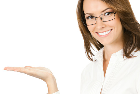 Portrait of young happy smiling businesswoman showing something or holding with copyspace, isolated over white background Stock Photo - 28319610