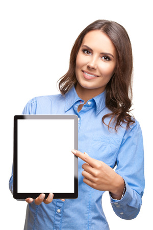 Happy smiling beautiful young business woman showing blank tablet pc for copyspace, isolated over white background photo