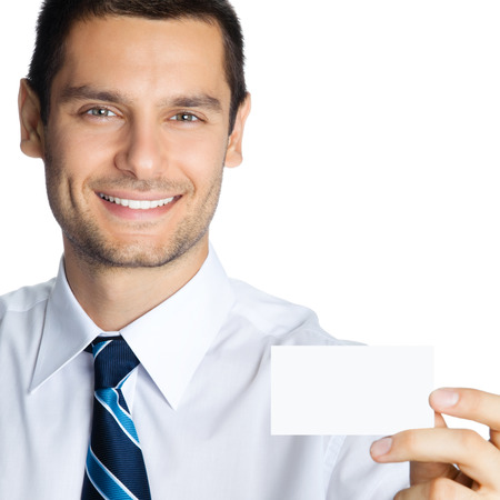 Portrait of smiling businessman showing blank business card, isolated on white background photo