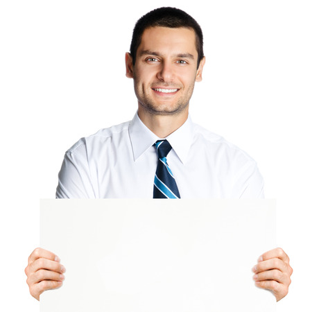 Portrait of happy smiling young business man showing blank signboard, isolated over white background Stock Photo - 28356219