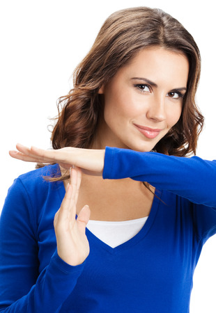woman stop: Happy smiling beautiful young woman showing time out gesture, isolated over white background