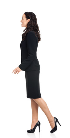 Full body of going young happy smiling business woman, isolated over white background photo