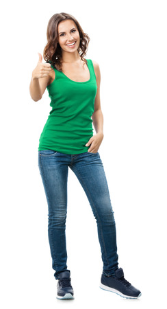 Full body portrait of happy smiling beautiful young woman showing thumbs up gesture, in smart green casual clothing, isolated over white background photo