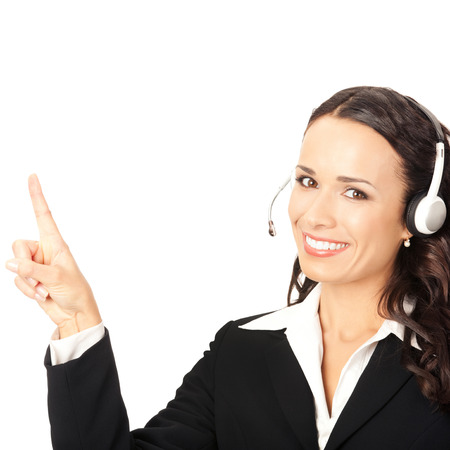 Portrait of happy smiling cheerful customer support phone operator in headset pointing at something, isolated on white background photo
