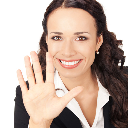 Happy smiling young business woman showing five fingers, isolated on white background photo
