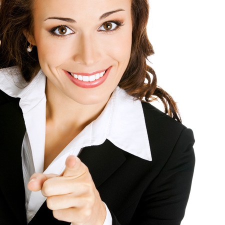 Portrait of young happy smiling business woman pointing finger at viewer, isolated over white background photo