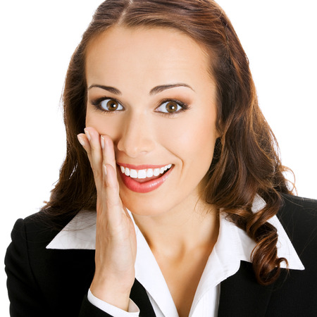 Portrait of happy smiling young business woman covering with hand her mouth, isolated on white background