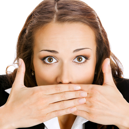 Portrait of surprised excited young business woman covering with hands her mouth, isolated on white background photo