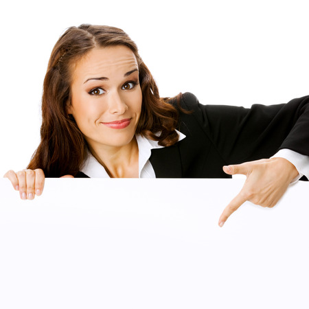 Happy smiling young business woman showing blank signboard, isolated on white background Stock Photo