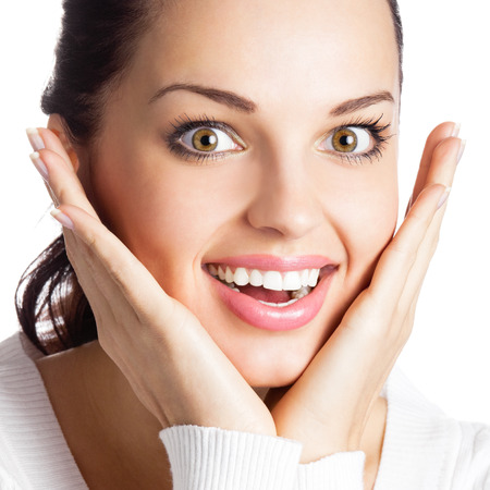 Portrait of very happy smiling young woman, isolated over white background photo
