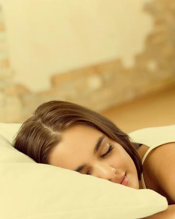 awaking: Young beautiful woman sleeping on bed