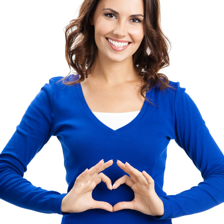 Happy smiling beautiful young woman showing heart symbol gesture, isolated over white background photo