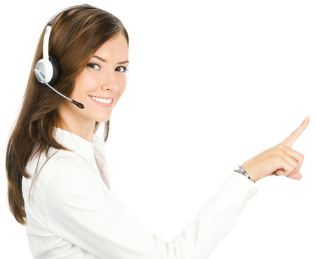 center agent: Portrait of smiling cheerful customer support phone operator in headset pointing at something, isolated on white background Stock Photo