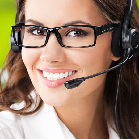 phone operator: Portrait of happy smiling young support phone operator in headset Stock Photo