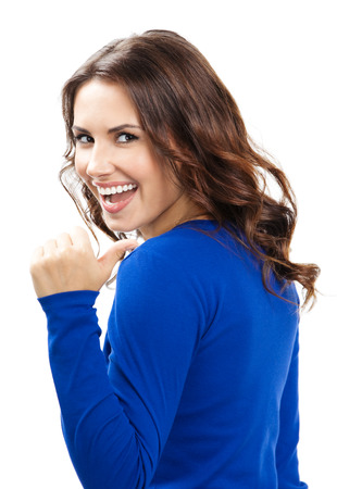 Happy smiling beautiful young woman showing thumbs up gesture, isolated over white background photo