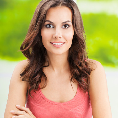 Portrait of beautiful young happy smiling woman, outdoors photo