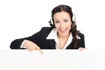 blank center: Happy smiling young customer support phone operator in headset showing blank signboard, isolated over white background Stock Photo