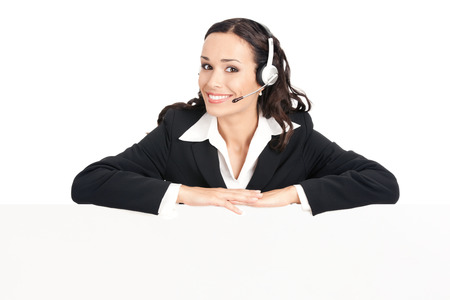 blank area: Happy smiling young customer support phone operator in headset showing blank signboard, isolated over white background Stock Photo