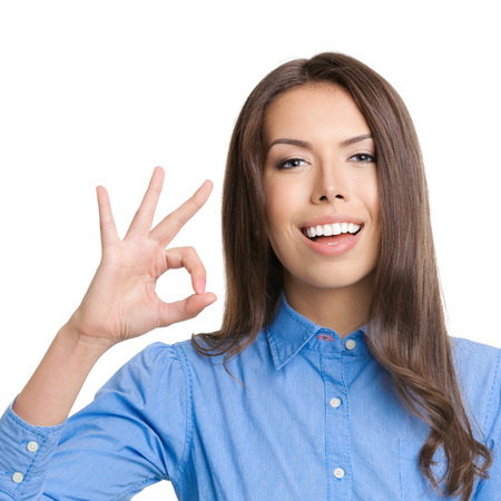 Happy smiling cheerful young business woman showing okay gesture, isolated over white background photo