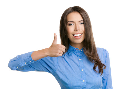 Happy smiling cheerful young business woman showing thumbs up gesture, isolated over white background photo