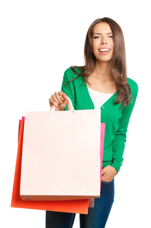 Portrait of young happy smiling woman with shopping bags, with copyspace, isolated over white background photo