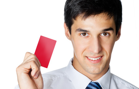 Portrait of happy smiling young business man giving blank red business or plastic credit card, isolated against white background photo