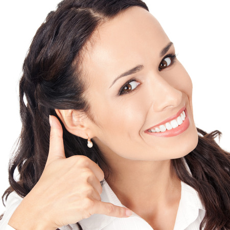 Young happy smiling business woman with call me gesture, isolated on white background photo