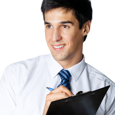 Happy smiling businessman writing, isolated against white backgound photo
