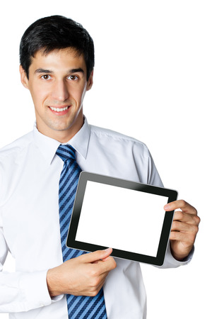 Portrait of happy smiling young businessman showing no-name blank taplet pc, isolated against white background photo