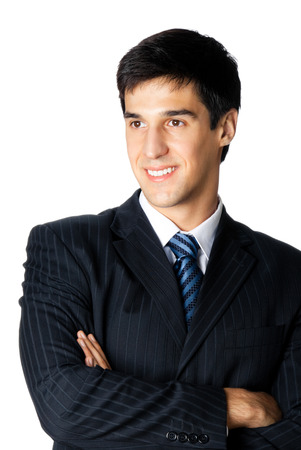 Portrait of happy smiling young businessman, isolated against white background photo
