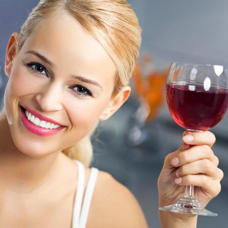 redwine: Happy woman with glass of redwine