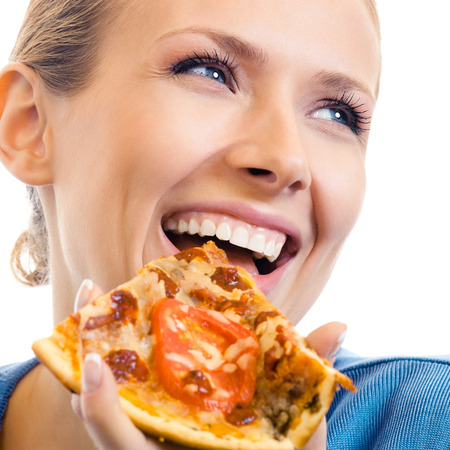 over eating: Woman eating pizza, isolated over white background Stock Photo