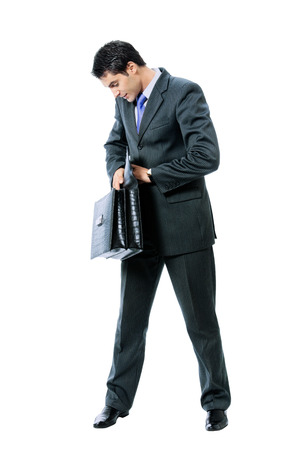 seach: Young businessman in blue tie with briefcase, isolated against white background Stock Photo
