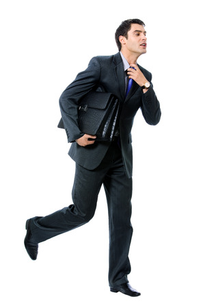 Very busy businessman with briefcase running to important meeting, isolated against white background photo
