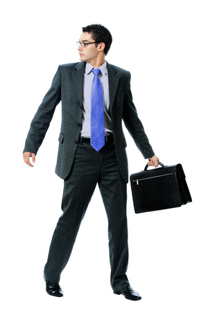 malefactor: Young businessman or hacker in sun glasses with briefcase, isolated against white background
