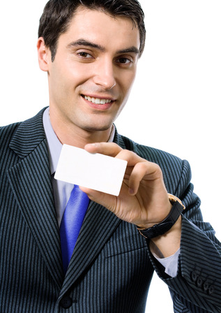 businesscard: Portrait of happy smiling businessman in blue tie, giving businesscard or bank credit card, isolated against white background