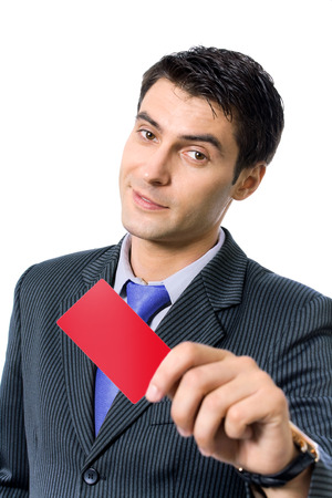 businesscard: Businessman in blue tie, giving blank red card or businesscard, isolated against white background Stock Photo